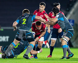 CJ Stander of Munster  under pressure from Dan Lydiate of Ospreys<br /> <br /> Photographer Simon King/Replay Images<br /> <br /> European Rugby Champions Cup Round 1 - Ospreys v Munster - Saturday 16th November 2019 - Liberty Stadium - Swansea<br /> <br /> World Copyright © Replay Images . All rights reserved. info@replayimages.co.uk - http://replayimages.co.uk