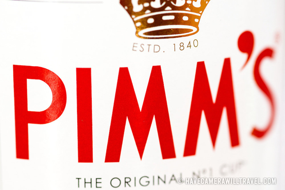 A close-up shot of the label on a bottle of Pimm's, a famous gin-based based English spirit with a proprietory blend of flavoring ingredients.