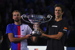 November 13, 2017 - London, England, United Kingdom - Lukasz Kubot (L) of Poland and Marcelo Melo of Brazil celebrates as they are given the Emirates ATP year end World Number One trophy after a presentation to them on the second day of the Nitto ATP World Tour Finals at O2 Arena, London on November 13, 2017. (Credit Image: © Alberto Pezzali/NurPhoto via ZUMA Press)