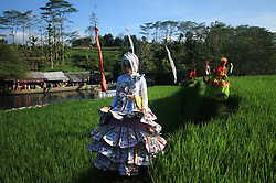 August 14, 2017 - Malang, EAST JAVA, Indonesia - A number of fashion show contest participants bring a variety of clothing that is in the title at the rice field, Sumber Maron tourist area, Village Pagelaran Malang. The event was just held this time in order to commemorate the 72nd anniversary of RI, as many as 27 participants follow the activity. (Credit Image: © Adhitya Hendra/Pacific Press via ZUMA Wire)