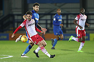 Stevanage midfielder Michael Timlin (4) battles for possession with AFC Wimbledon midfielder Anthony Wordsworth (40) during the EFL Trophy group stage match between AFC Wimbledon and Stevenage at the Cherry Red Records Stadium, Kingston, England on 6 November 2018.