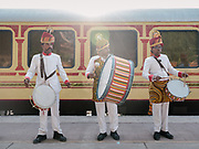 A brass band welcomes passengers on the Palace on Wheels, a vintage luxury train crossing Rajahstan province.