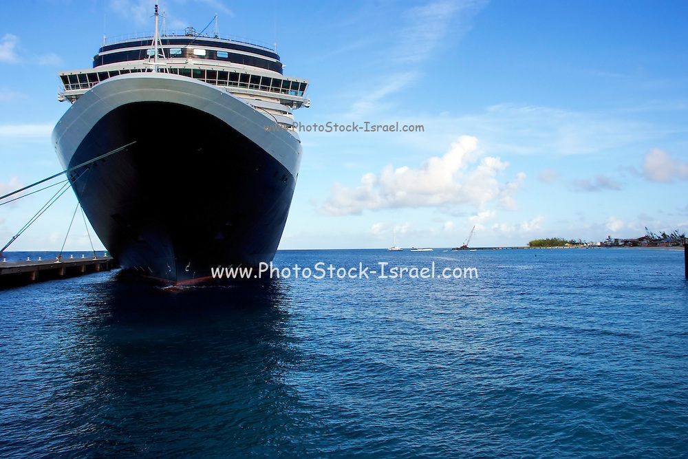 Low angle view of the stern of a cruise ship, with no markings, tied to a dock in Florida