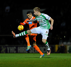 Yeovil Town's Byron Webster and Blackpool's Thomas Ince contend for the ball - Photo mandatory by-line: Joe Meredith/JMP - Tel: Mobile: 07966 386802 03/12/2013 - SPORT - Football - Yeovil - Huish Park - Yeovil Town v Blackpool - Sky Bet Championship