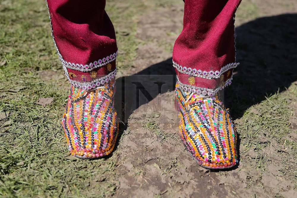 © Licensed to London News Pictures. 29/08/2016. Leeds, UK. A man wears shoes covered in colourful gems at Leeds West Indian Carnival in Leeds, West Yorkshire. First run in the 1960's, the Leeds West Indian Carnival is Europe's longest running authentic Caribbean carnival parade. Photo credit : Ian Hinchliffe/LNP