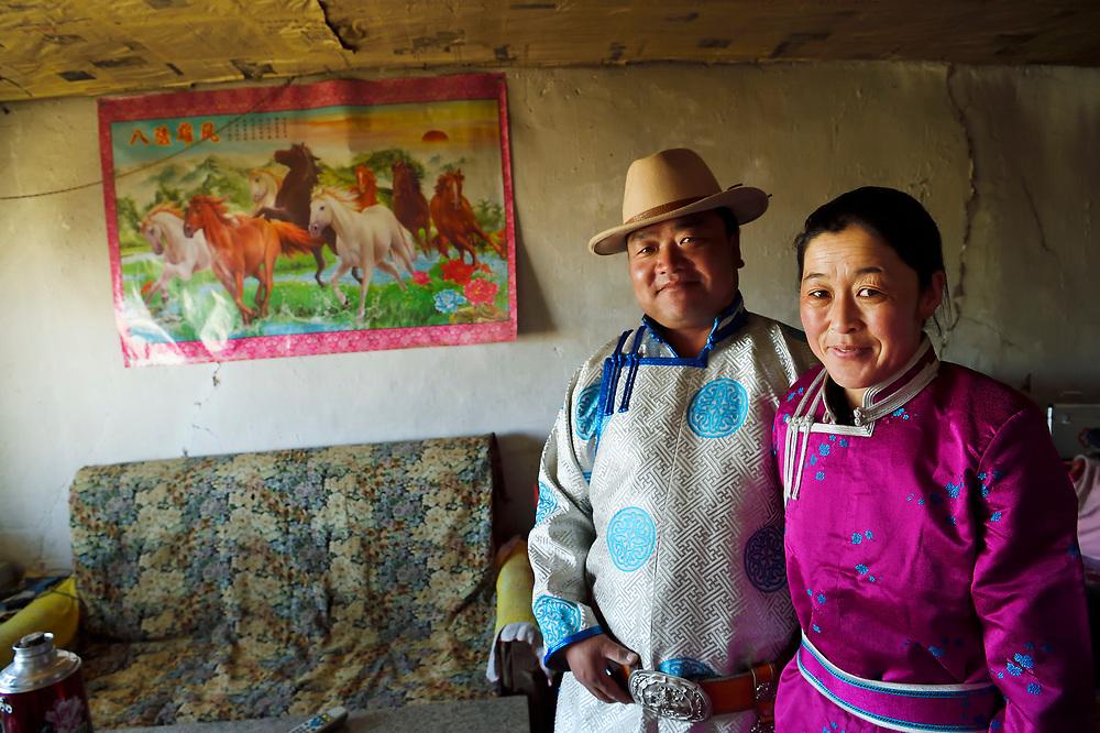 Mongolian Shepherd Ge Ri Li Ao De with his wife Ao Te Gen,in living room, Inner Mongolia, China
