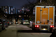 A Sainsbury's delivery van makes a drop-off of an online shopping order for customers living in a dark residential street in Herne Hill, south London, on 21st January 2021, in London, England.