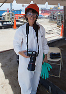 Julie Dermansky in protective gear while shooting the clean up of the BP oil spill