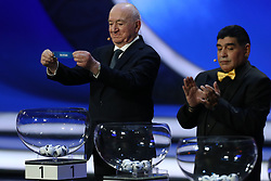 December 1, 2017 - Moscow, Russia - Draw assistant, Nikita Simonyan (L) draws Russia during the Final Draw for the 2018 FIFA World Cup Russia at the State Kremlin Palace on December 1, 2017 in Moscow, Russia. (Credit Image: © Igor Russak/NurPhoto via ZUMA Press)