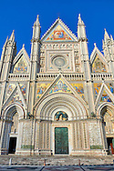 Facade close up of the14th century Tuscan Gothic style facade of the Cathedral of Orvieto, designed by Maitani, Umbria, Italy .<br /> <br /> Visit our ITALY HISTORIC PLACES PHOTO COLLECTION for more   photos of Italy to download or buy as prints https://funkystock.photoshelter.com/gallery-collection/2b-Pictures-Images-of-Italy-Photos-of-Italian-Historic-Landmark-Sites/C0000qxA2zGFjd_k<br /> .<br /> <br /> Visit our MEDIEVAL PHOTO COLLECTIONS for more   photos  to download or buy as prints https://funkystock.photoshelter.com/gallery-collection/Medieval-Middle-Ages-Historic-Places-Arcaeological-Sites-Pictures-Images-of/C0000B5ZA54_WD0s