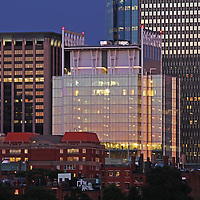 Boston skyline photography showing historic landmarks such as the Prudential Center and the newly constructed glass architecture office tower at 888 Boylston Street in the Back Bay.<br />