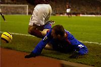 Photo: Daniel Hambury.<br />Arsenal v Manchester United. The Barclays Premiership.<br />03/01/2006.<br />United's Wayne Rooney tackles Jose Antonio Reyes beyond the pitch.