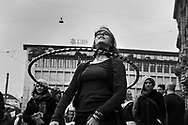 Young woman dancing with a hoop, amongst Occupy movement demonstrators on Paradeplatz, centre of the Swiss banking industry.