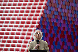 Artist Christo addresses the media and gathered VIPs as he unveils his 20m high installation on The Serpentine made from over 7000 barrels, titled The Mastaba, which will be on the Serpentine until 23 September 2018. The Installation is comprised of 7,506 horizontally stacked barrels. It is 20m high, 30m wide and 40m long. Hyde Park, London, June 18 2018.