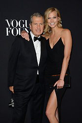 File photo : Mario Testino and Karlie Kloss attending the Vogue Foundation Gala as part of Paris Fashion Week at Palais Galliera in Paris, France on July 9, 2014. Photographer to the stars Mario Testino is a favourite of the Royal Family but he is facing a stream of sexual misconduct allegations from male models. Fashion brands Burberry and Michael Kors moved quickly to cut ties with him. He had been a front-runner to be the official photographer at the wedding of Prince Harry and Meghan Markle but has been ruled out following the uproar. Photo by Nicolas Briquet/ABACAPRESS.COM
