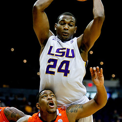January 17, 2012; Baton Rouge, LA; LSU Tigers forward Storm Warren (24) rebounds over Auburn Tigers guard Frankie Sullivan (23) during the first half of a game at the Pete Maravich Assembly Center.  Mandatory Credit: Derick E. Hingle-US PRESSWIRE