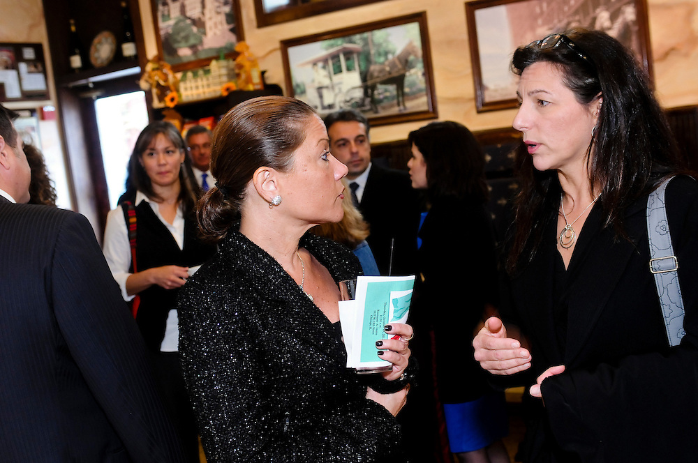 """Denise Solofra (L) of the Cook County Clerks Office chats with Gina Savini at an Italian-American Heritage Month luncheon honoring Savini's brother, CBS investigative reporter Dave Savini, is among others being honored at Ristorante Al Teatro in Chicago's Pilsen neighborhood. Also being honored are John Locallo, Past President of the Illinois Bar Association and Partner at the law firm of Amari & Locallo and Ferdinand """"Fred"""" Serpe of the Law Office Of Ferdinand Serpe & Associates. © 2012 Brian J. Morowczynski ViaPhotos"""