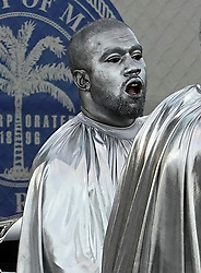 Kanye West dresses in silver body paint and a billowing silver robe as he appears at his latest opera in Miami. 08 Dec 2019 Pictured: Kanye West. Photo credit: MEGA TheMegaAgency.com +1 888 505 6342