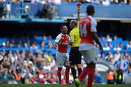 Referee Michael Dean gives a red card and sends off Santi Cazorla of Arsenal who looks on in disbelief. Barclays Premier League match, Chelsea v Arsenal at Stamford Bridge in London on Saturday 19th September 2015.<br /> pic by John Patrick Fletcher, Andrew Orchard sports photography.