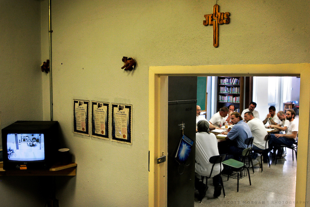 A television displays the security video of worshipers, seen through the door of the Chaplains office, during a Good Friday service Friday April 14, 2006 at the Mount Pleasant Correctional Facility.<br /> Scott Morgan/The Hawk Eye