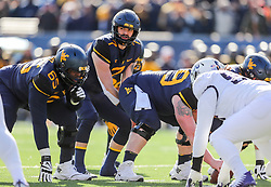 Nov 10, 2018; Morgantown, WV, USA; West Virginia Mountaineers quarterback Will Grier (7) pauses over center during the second quarter against the TCU Horned Frogs at Mountaineer Field at Milan Puskar Stadium. Mandatory Credit: Ben Queen-USA TODAY Sports