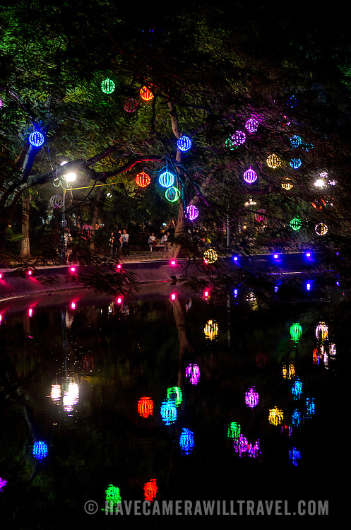 Colorful lights hanging from the trees on the northeastern shore of Hoan Kiem Lake  in Hanoi.