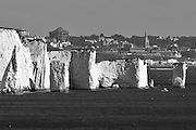 Old Harry Rocks with Bournemouth behind. Dorset, UK.