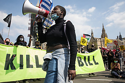 London, UK. 29th May, 2021. Activists from civil liberties groups pause outside Parliament during a Kill The Bill National Day of Action in protest against the Police, Crime, Sentencing and Courts (PCSC) Bill 2021. The PCSC Bill would grant the police a range of new discretionary powers to shut down protests, including the ability to impose conditions on any protest deemed to be disruptive to the local community, wider stop and search powers and sentences of up to 10 years in prison for damaging memorials.