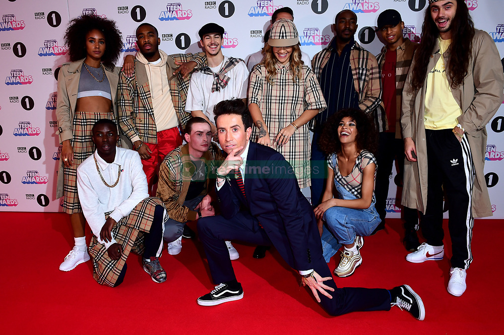 Rita Ora (centre back) and Nick Grimshaw (front) attending BBC Radio 1's Teen Awards, at the SSE Arena, Wembley, London.