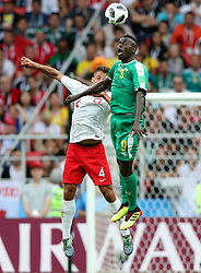 MOSCOW, June 19, 2018  Thiago Cionek (L) of Poland vies with Mame Biram Diouf of Senegal during a Group H match between Poland and Senegal at the 2018 FIFA World Cup in Moscow, Russia, June 19, 2018. (Credit Image: © Xu Zijian/Xinhua via ZUMA Wire)