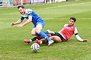 Ben House of Eastleigh is brought down by Kyran Lofthouse during the Vanarama National League match between Eastleigh and Woking at Silverlake Stadium, Eastleigh, United Kingdom on 10 April 2021.