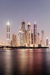 Evening skyline view of skyscrapers in Marina district of Dubai United Arab Emirates