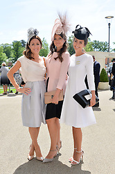 Left to right, NATALIE PINKHAM, LADY NATASHA RUFUS ISAACS and LAVINIA BRENNAN at the first day of the 2014 Royal Ascot Racing Festival, Ascot Racecourse, Ascot, Berkshire on 17th June 2014.
