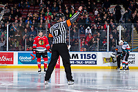 KELOWNA, CANADA - MARCH 2:  Referee Steve Papp stands at centre ice and calls for the face off between the Kelowna Rockets and the Portland Winterhawks on March 2, 2019 at Prospera Place in Kelowna, British Columbia, Canada.  (Photo by Marissa Baecker/Shoot the Breeze)