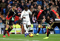 MADRID, Dec. 16, 2018  Real Madrid's Vinicius Junior (2nd L) dribbles during a Spanish league match between Real Madrid and Rayo Vallecano in Madrid, Spain, on December 15, 2018. Real Madrid won 1-0. (Credit Image: © Edward F. Peters/Xinhua via ZUMA Wire)