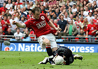Photo: Paul Thomas.<br /> Chelsea v Manchester United. The FA Cup Final. 19/05/2007.<br /> <br /> Wayne Rooney (Red) of Utd just has the ball saved from him by keeper Petr Cech.