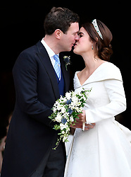 Princess Eugenie and Jack Brooksbank kiss as they leave after their wedding at St George's Chapel in Windsor Castle, Windsor.