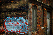 SHOT 10/13/09 9:46:04 AM - Graffiti on the side of a weathered brick building in downtown Buffalo, NY. Buffalo, N.Y. is the second most populous city in the state of New York and is located in Western New York on the eastern shores of Lake Erie and at the head of the Niagara River. By 1900, Buffalo was the 8th largest city in the country, and went on to become a major railroad hub, the largest grain-milling center in the country and the home of the largest steel-making operation in the world. The latter part of the 20th Century saw a reversal of fortunes: by the year 1990 the city had fallen back below its 1900 population levels. (Photo by Marc Piscotty / © 2009)