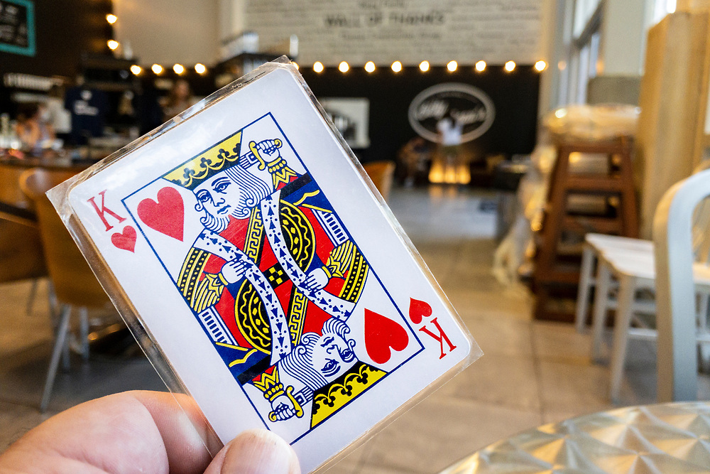 A laminated playing card used for picking up your order at Bitty & Beau's Coffee - the original location at Flow Cadillac of Wilmington - in Wilmington, North Carolina on Friday, August 13, 2021. Copyright 2021 Jason Barnette