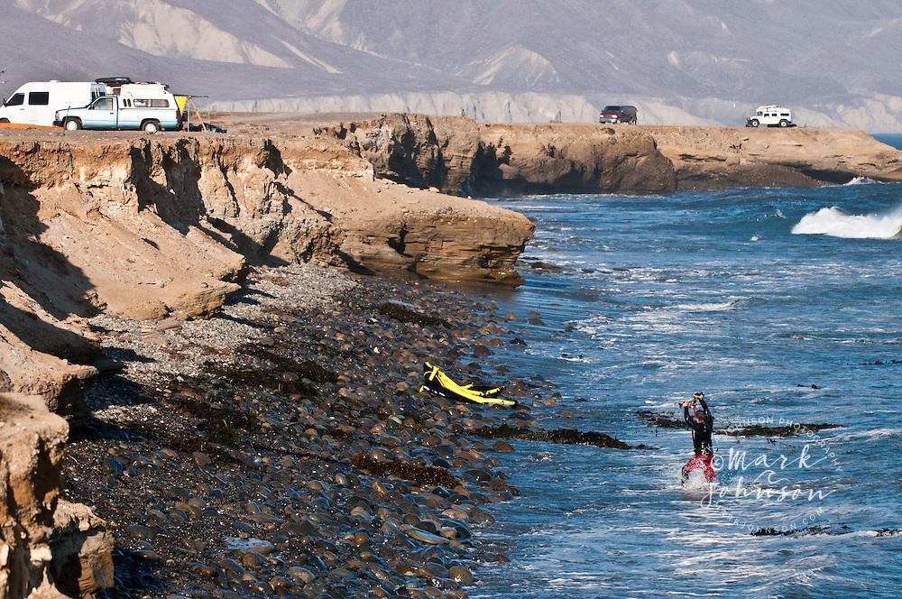 Kitesurfer & crashed kite and tangled lines in the seaweed, Punto San Carlos, Baja California, Mexico