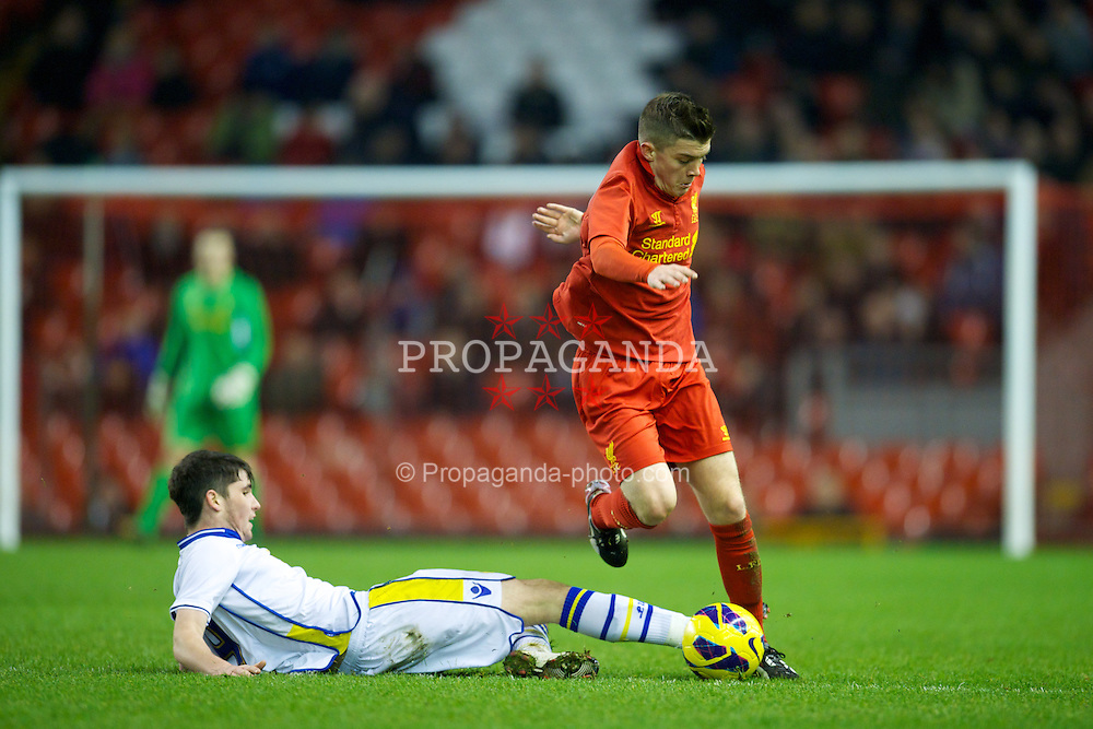 LIVERPOOL, ENGLAND - Thursday, February 28, 2013: Liverpool's Daniel Trickett-Smith in action against Leeds United's Alex Purver during the FA Youth Cup 5th Round match at Anfield. (Pic by David Rawcliffe/Propaganda)