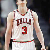 26 March 2012: Chicago Bulls center Omer Asik (3) eyes the big screen during the Denver Nuggets 108-91 victory over the Chicago Bulls at the United Center, Chicago, Illinois, USA. NOTE TO USER: User expressly acknowledges and agrees that, by downloading and or using this photograph, User is consenting to the terms and conditions of the Getty Images License Agreement. Mandatory Credit: 2012 NBAE (Photo by Chris Elise/NBAE via Getty Images)