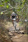 SHOT 6/4/11 12:47:59 PM - Pro mountain bike racer Jeremy Horgan-Korbelski crosses a bridge on the course during the Men's Pro race at the 10th Annual Teva Mountain Games in Vail, Co. Horgan-Korbelski won the event with a time of 1:26:22. Professional and amateur outdoor adventure athletes from the Vail Valley and around the world will converge upon the mountains and rivers of Vail to compete in eight sports and 23 disciplines including: x-country, freeride, slopestyle and road cycling, freestyle, 8-Ball, sprint and extreme kayaking, raft cross, World Cup Bouldering, stand up paddle sprint and surf cross, as well as trail, mud and road running, dog comps and the GNC Ultimate Mountain Challenge.. (Photo by Marc Piscotty / © 2010)