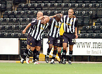 Photo: Leigh Quinnell.<br /> Notts County v Wycombe Wanderers. Coca Cola League 2. 12/08/2006. Notts Countys Junior Mendes(centre) celebrates his goal with his team mates.