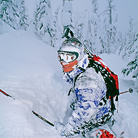 A skier recovers after a  crash in powder snow at the Big Mountain, Montana.