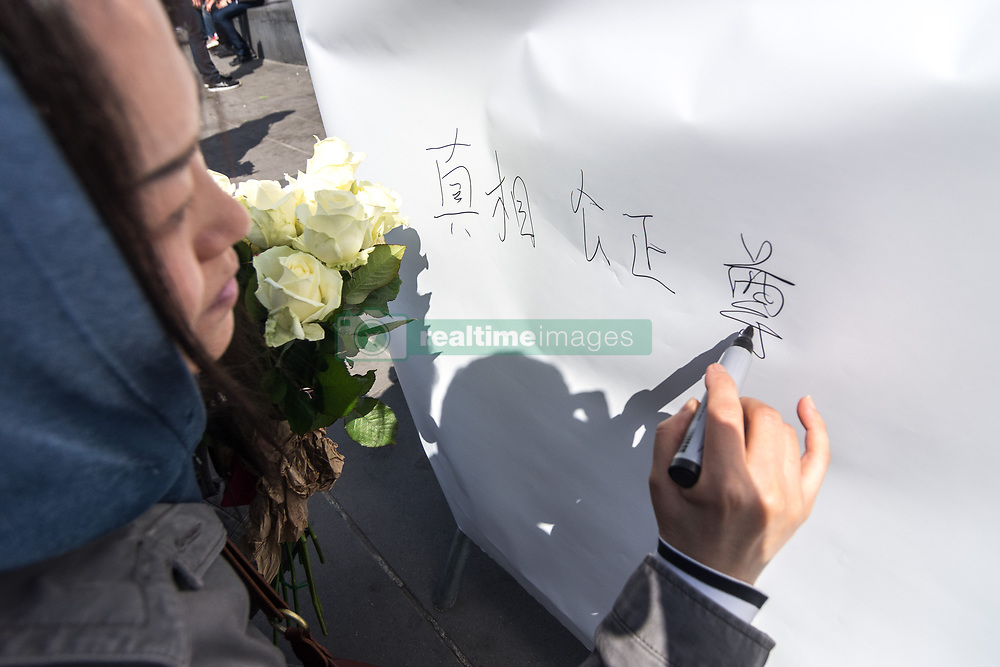 April 2, 2017 - Paris, France - People hold up roses as they gather at Place de la Republique in Paris, France on April 2, 2017, to mourn the death of Shaoyao Liu during a police intervention last week. The people cried for justice and truth over the death of the 56-year-old father. There have been rallies in Paris for the past week over the issue, with many police/protester clashes. (Credit Image: © Julien Mattia/NurPhoto via ZUMA Press)