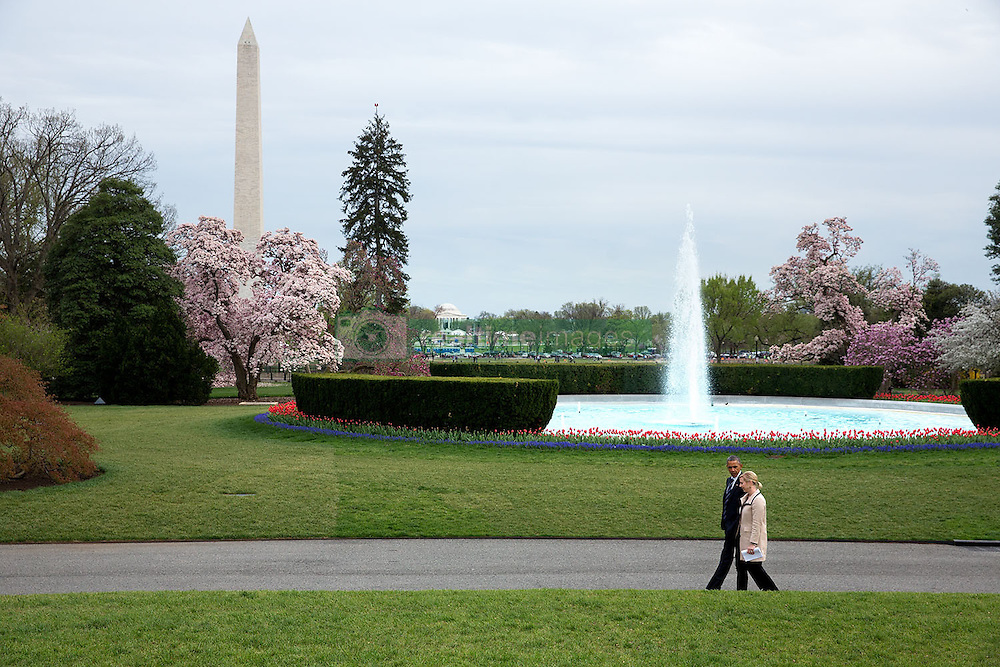 President Barack Obama walks with Anita Breckenridge, Deputy Chief of Staff for Operations, on the South Grounds of the White House, April 15, 2015. (Official White House Photo by Chuck Kennedy)<br /> <br /> This official White House photograph is being made available only for publication by news organizations and/or for personal use printing by the subject(s) of the photograph. The photograph may not be manipulated in any way and may not be used in commercial or political materials, advertisements, emails, products, promotions that in any way suggests approval or endorsement of the President, the First Family, or the White House.