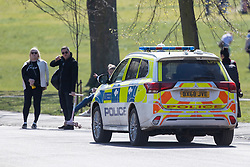 © Licensed to London News Pictures. 18/04/2021. London, UK. Police patrol as members of the public relax and enjoy the sunny weather in Greenwich Park in South East London. Temperatures are expected to rise with highs of 16 degrees forecasted for parts of London and South East England this week . Photo credit: George Cracknell Wright/LNP