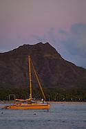 Catamaran below Diamond Head Crater, Waikiki Beach, Honolulu, Oahu, Hawaii