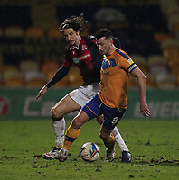 Bolton Wanderers Jordan Williams in action with Mansfield Town's Ollie Clarke<br /> <br /> Photographer Mick Walker/CameraSport<br /> <br /> The EFL League 2 - Mansfield Town v Bolton Wanderers  - Wednesday 17th February  2021 - One Call Stadium-Mansfield<br /> <br /> World Copyright © 2020 CameraSport. All rights reserved. 43 Linden Ave. Countesthorpe. Leicester. England. LE8 5PG - Tel: +44 (0) 116 277 4147 - admin@camerasport.com - www.camerasport.com